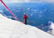 Climber on a snowy ridge Stock Image