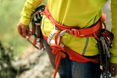 Climber standing with climbing gears and rope Royalty Free Stock Images
