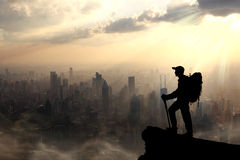 Climber standing on summit of mountain. Royalty Free Stock Photos