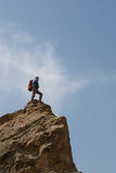 Climber stands at top Stock Image