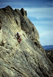 Climber on steep rock face Royalty Free Stock Photo