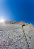 Climber on a steep rock wall Stock Photo