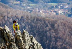 Climber struggle to the summit of a challenging ridge Royalty Free Stock Photo