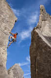 Climber struggles up a cliff. Royalty Free Stock Photos