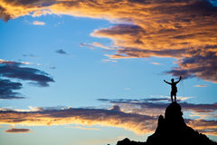 Climber on the summit. Stock Images