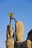 Climber on the summit. Stock Photo