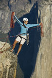 Climber on the summit. Climber on the summit of a rock monolith in Yosemite National Park, California, on a sunny day Stock Photo