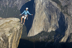 Climber on the summit. Climber on the summit of a rock monolith in Yosemite National Park, California, on a sunny day Royalty Free Stock Image