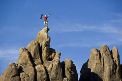 Climber on the summit. Stock Photos