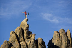 Climber on the summit. Royalty Free Stock Photography
