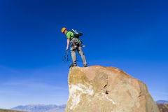 Climber on the summit. Royalty Free Stock Photos