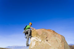 Climber on the summit. Royalty Free Stock Photo