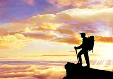 Climber on summit of a mountain. Royalty Free Stock Photography