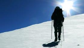 Climber and sun Stock Photography