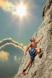 Climber on sunset on the rock Royalty Free Stock Images