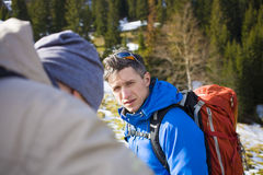 Climber talking to his friend. Climber talking to his partner before climbing into the mountains Stock Photo