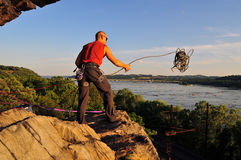 Climber throwing his rope Royalty Free Stock Photo