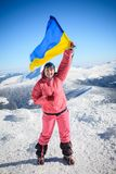 Climber, top, flag, Ukraine Royalty Free Stock Image