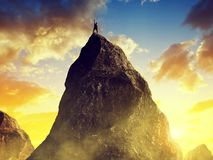 Climber on the top of the mountain. Stock Image
