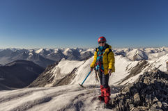 Climber on top of a mountain in Kyrgyzstan. During mountain trekking fourth category of complexity, the picture was taken on top of the mountain, Terskey Tau Royalty Free Stock Image