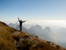 Climber at the top of a mountain after rock climbing Royalty Free Stock Photo