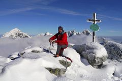 Climber on top of the mountain in winter Stock Images