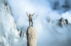 Climber on the top. Climber on the summit of a challenging cliff Stock Photo