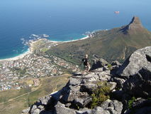 Climber. On top of Table Mountain over looking Camps Bay Stock Photo