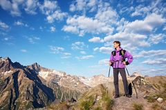 Climber on trail in the mountains. a man with backpack in a hike stock image