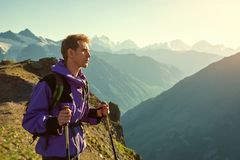 Climber on trail in the mountains. a man with backpack in a hike stock photography