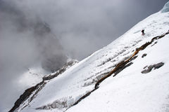 Climber traversing mountain slope, Himalayas Royalty Free Stock Image