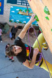 Climber trying to reach a hold on Climbing Wall Royalty Free Stock Photo