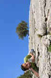 Climber-two. A climber who quenchs thirst on a rock face Stock Photos