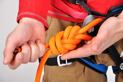 Climber tying double bowline knot. Close up stock images