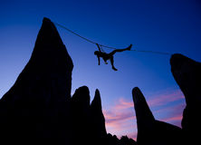 Climber on a tyrolean traverse. Royalty Free Stock Images