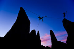 Climber on a tyrolean traverse. royalty free stock photos