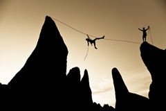 Climber on a tyrolean traverse. Royalty Free Stock Photography
