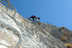 Climber on a via ferrata Royalty Free Stock Photos
