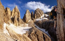 Climber on via ferrata or klettersteig in Italy Stock Image