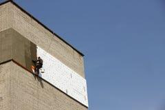 Climber warms facade Stock Photo