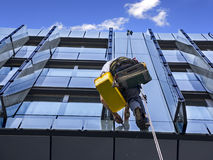 Climber wash glass facade Stock Images