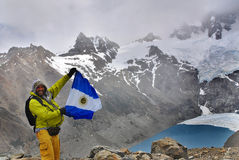 Climber wave a flag of Argentina Stock Photo