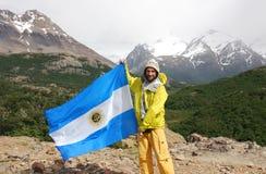 Climber waving a flag of Argentina Stock Photography