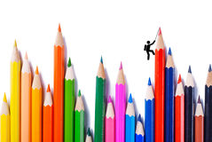 Climber who climbs the colour pencils Stock Image
