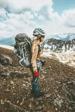 Climber woman with backpack on hike in mountains Royalty Free Stock Image