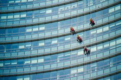 Climber workers for glass cleaning at Porta Garibaldi district, Piazza Gae Aulenti. Stock Images