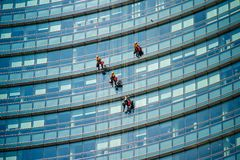 Climber workers for glass cleaning at Porta Garibaldi district, Piazza Gae Aulenti. MILAN, ITALY - SEPTEMBER 19,2017: Climber workers for glass cleaning at Stock Image