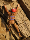 Climber on the yellow rock. Extremal sport background with climber on the yellow red volcanic rock climbing up Royalty Free Stock Photos