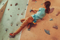 Climber young woman exercising indoor Stock Image