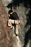 Climberdave0. A rock climber skillfully makes his way up the wall royalty free stock photos